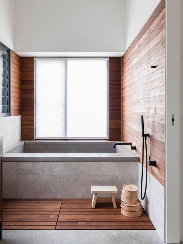 concrete-bathtub-design-with-wood-elements