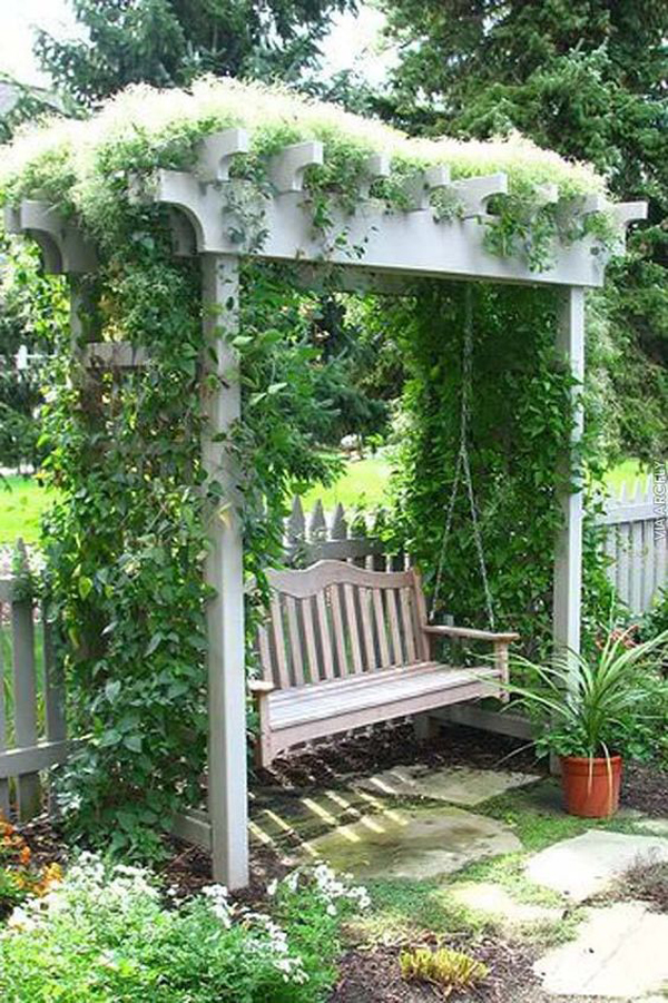 litlle-pergola-garden-nook-with-swing-chairs