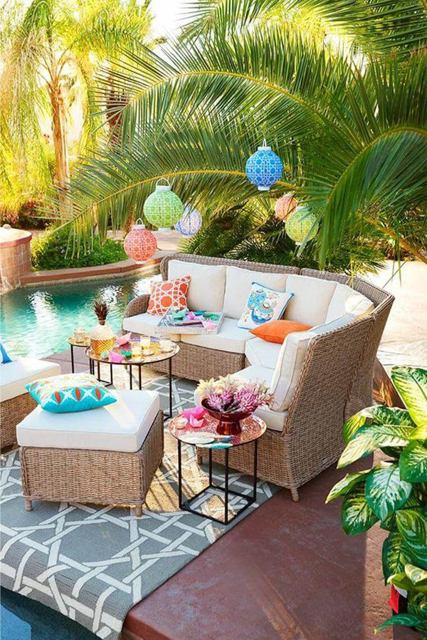 relaxing-outdoor-pool-seating-with-rattan-furniture