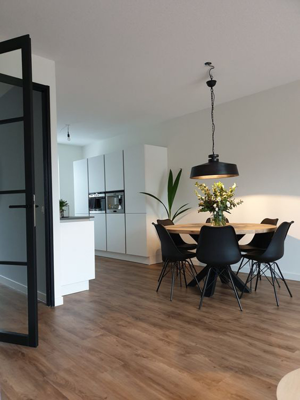round-dining-space-with-black-chairs