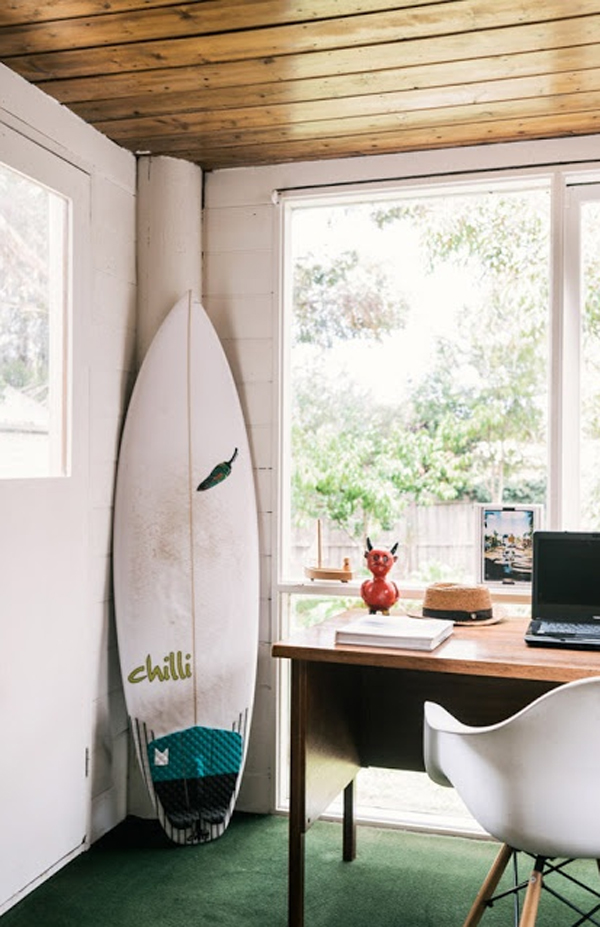 beach-style-home-office-with-surfboard-display