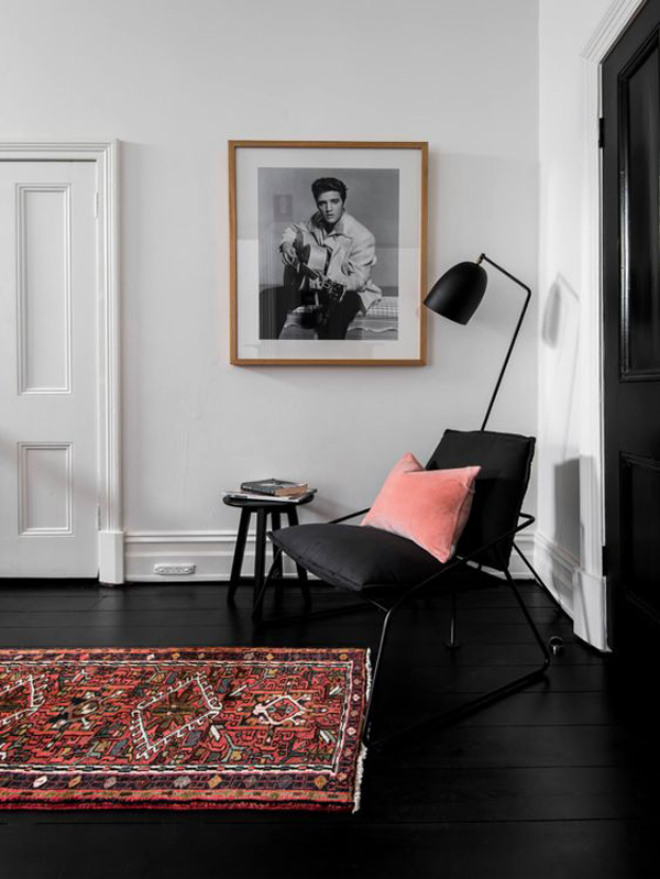 black-reading-chair-and-floor-with-bohemian-rugs
