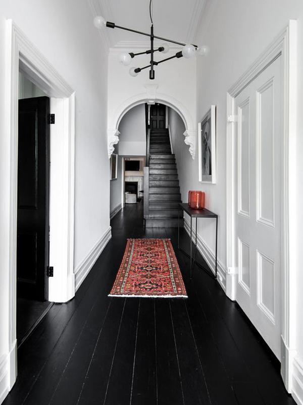 black-wood-hallway-floor-with-moroccan-rugs