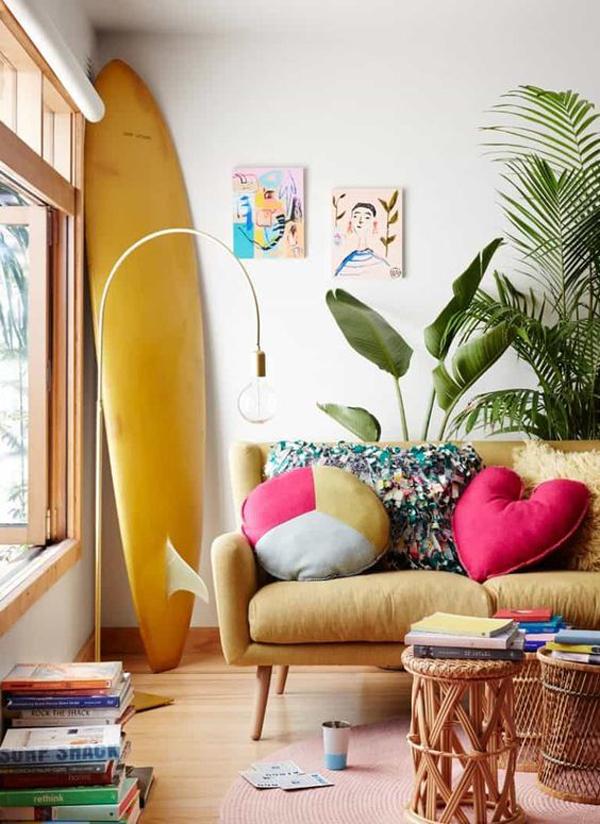 bohemian-coastal-living-room-design-with-surfboard-display