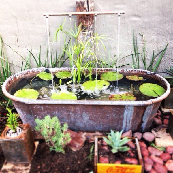 diy-old-bathtub-pond-with-water-fountain