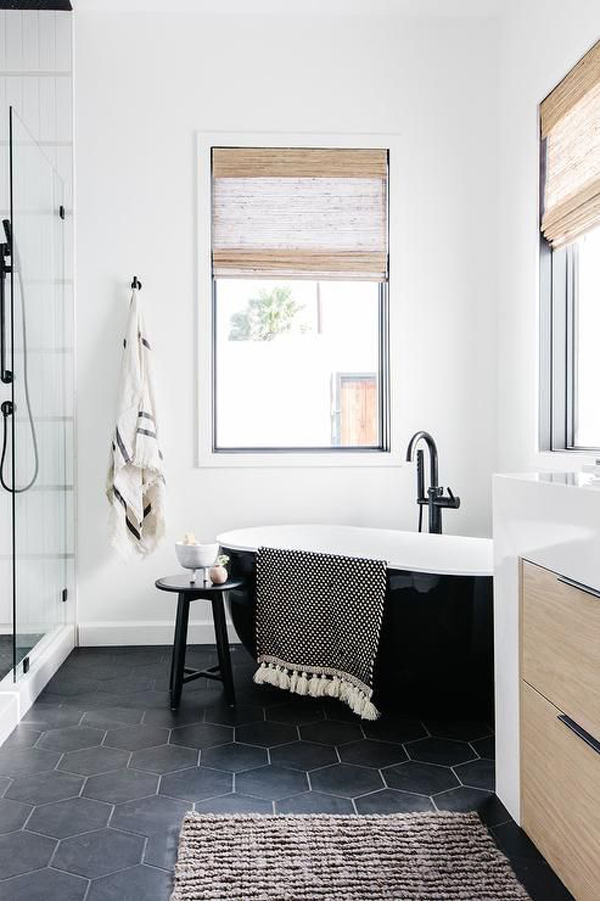 small-corner-bathtub-with-black-hexagon-floor-tiles