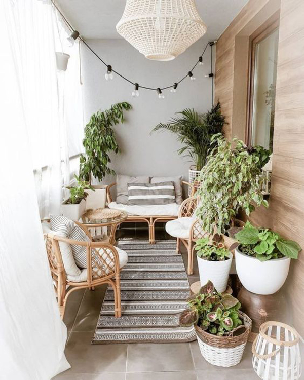 summer-private-balcony-with-rugs-and-rattan-furniture