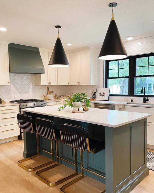 trendy-kitchen-with-green-cabinetry-and-kitchen-island