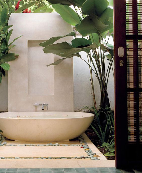 cozy-indoor-outdoor-bathroom-with-tropical-garden