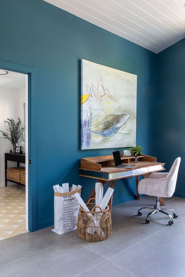 mid-century-home-office-with-dark-blue-accent-wall