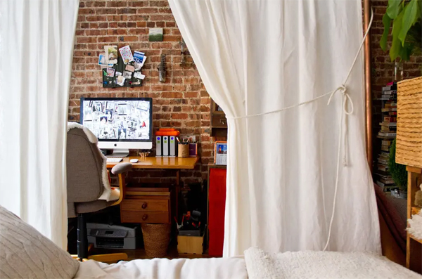 small-home-office-with-curtain-and-brick-exposed