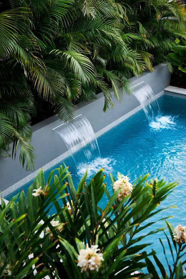 tropical-poolside-garden-with-water-fountain