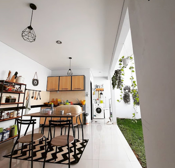 open-kitchen-and-dining-room-with-small-laundry-space