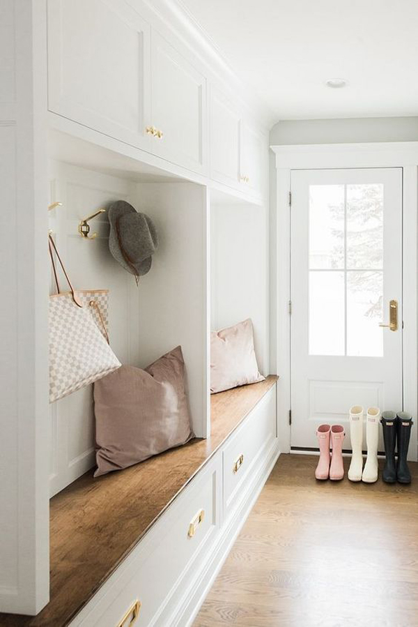 white-mudroom-organize-with-wood-stained-bench-and-hardwood-floors