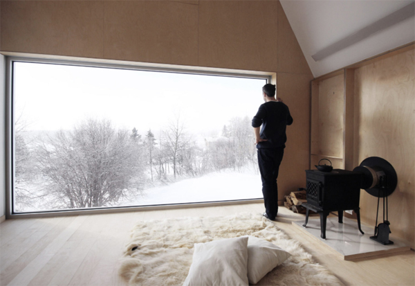 cozy-high-house-interior-with-large-window-view