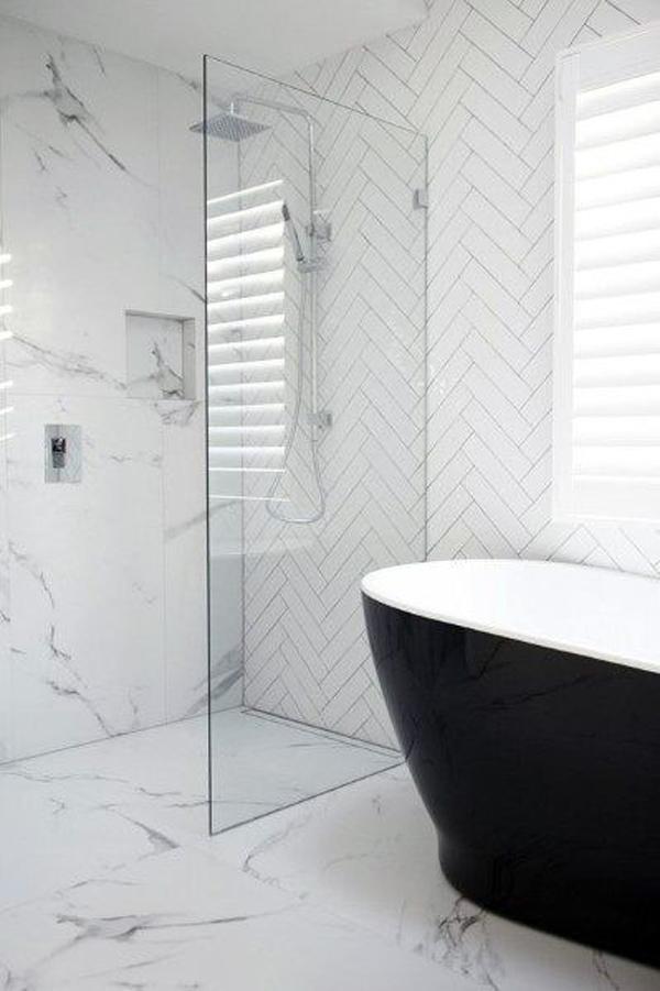 small-white-bathroom-design-with-black-bathtub