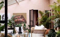 vintage-tropical-sunroom-design-with-pink-accent