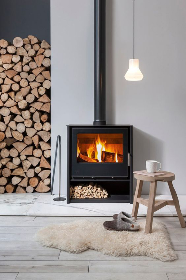 contempory-wood-burning-stove-with-built-in-firewood-store