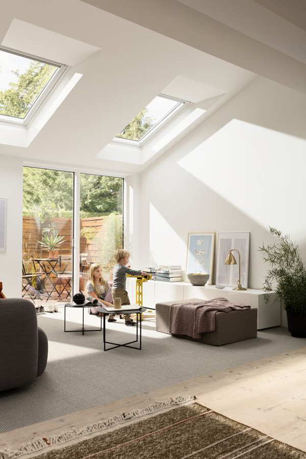 cozy-family-room-with-glass-wall-and-skylights