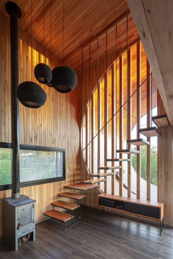 floating-staircase-design-with-traditional-fireplace