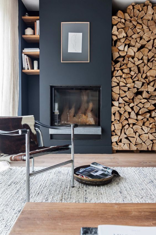 modern-rustic-interior-with-built-in-fireplace-and-firewood-store